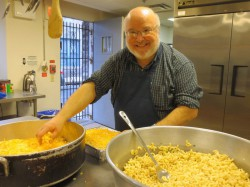 Exec. Director Bob Emberger preps some mac & cheese for the men to enjoy