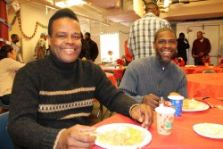 Derrick and Steve enjoy each other's company at a Christmas luncheon.