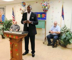 Robert shares his testimony with the men as he graduates from the Mission's New Life Program