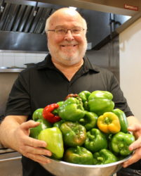 Executive Director Bob Emberger with the peppers he just harvested from our garden