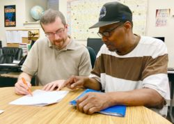 Eugene (right) works with Learning Program Director, Jason, on Vocational Discovery